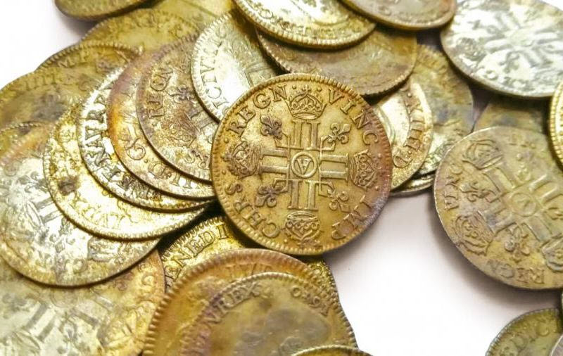 Workers discovered a treasure trove of rare gold coins, pictured, on the walls of a historic French mansion in 2019
