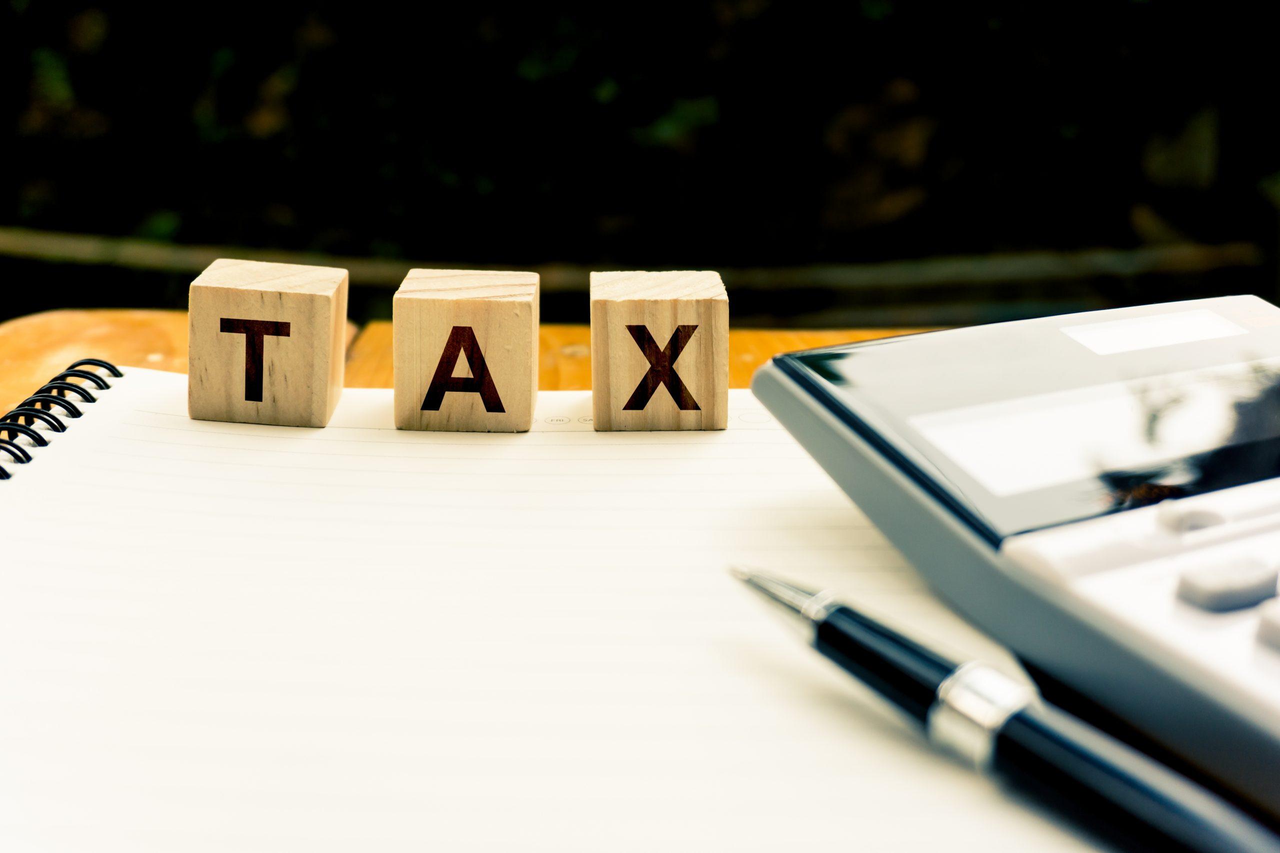 tax in wooden blocks