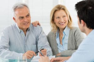Senior Couple Talking With A Consultant Regarding Gold Investing