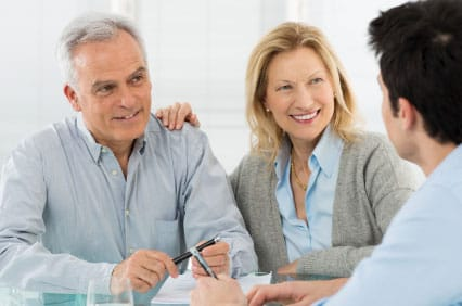Senior Couple Talking With A Consultant Regarding Gold IRA Accounts.