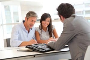 Ira Specialist Couple reviewing their gold options with gold IRA specialist