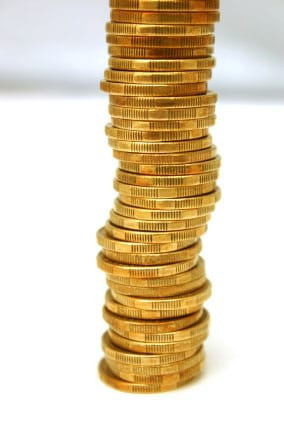 A Stack of Gold Coins To Consider When Investing In Gold and Silver!