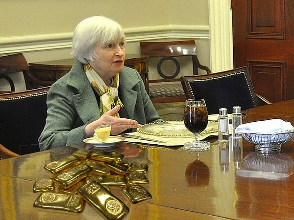 Janet Yellen with gold bars
