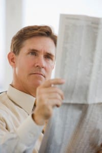 Man checking prices because he is interested in buying gold