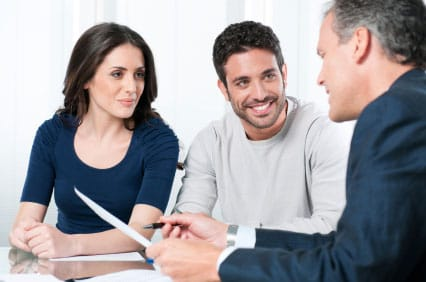 Specialist Working With Couple Investing In Gold and Silver