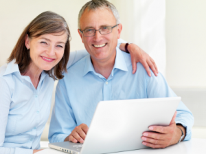 Savvy Couple Sitting With Laptop Buying Gold Bullion