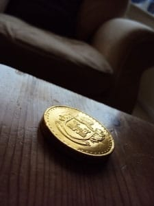 Gold coin on a wooden table
