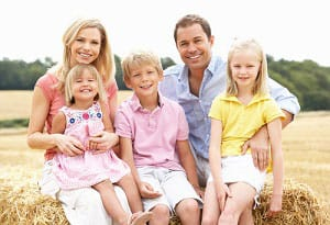Family of 5 Sitting Smiling | Guide To Investing In Gold