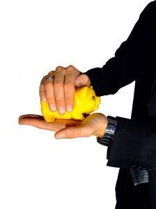 A man holding a golden piggy bank